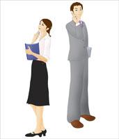 携帯電話をかけるスーツ姿の男女