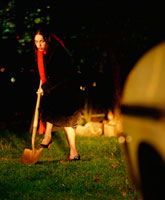 Woman digging at night