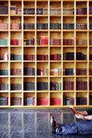 Man reading on library floor