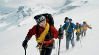 climbers in snow-covered peaks