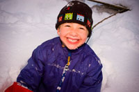 boy smiling in snow