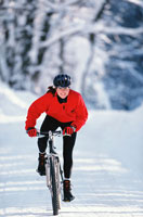 Woman biking through snow