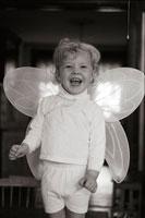 girl wearing fairy wings
