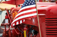 American flag on red tractor