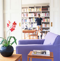 a girl beside a bookshelves