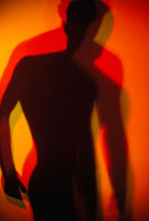 a silhouette of a man in move