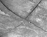 A cross-shaped crack in a stone