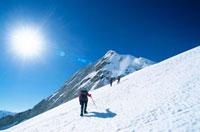 Three people hiking in the Himalayan mountains.