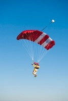 Mid adult woman parachuting