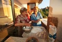 Senior women preparing food