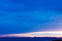 沈む夕日と町並み