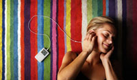 Young woman listening to IPOD