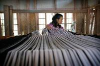 A Mizo woman with mechanical handloom