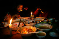 Mizo family eating dinner by candle