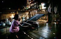 Bru tribe woman weaving