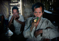 Bru tribe elder drinking rice beer
