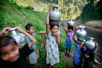 Bru tribe children collecting water