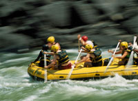Rafters going down rapids near