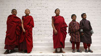 Monks standing by wall