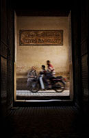 Motorbike passing entrance of Ali Ben Youssef Medersa