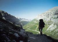 Walker going along path through the Ordesa Canyon