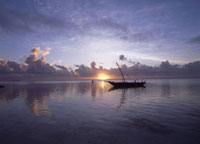 Dhow in calm waters at low tide at dawn