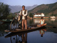 Man with bicycle on Shikara boat,Dal Lake