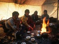 Tibetan Yak herders inside wool tent