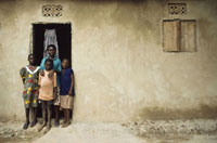 Family standing outside their house