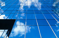 Sky and clouds reflected in a glass building