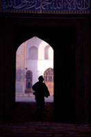 Boy silouhetted against the opening of Mosque