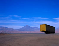 Yellow truck trailer abandoned in desert