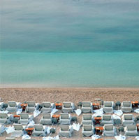 Deck chairs on empty beach