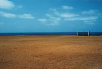 Empty football pitch by the ocean