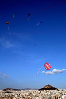Kites flying above Athens on Clean Monday with Licabettus Hi