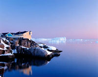 Houses on the coastline with icebergs,Disko Bay