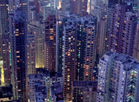 Looking down on crowded residential tower blocks as seen fro