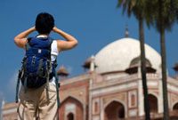 Woman with backpack admiring Humayun's tomb,Rear View