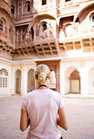 Blond tourist looking at building in Fort Mehrangarh