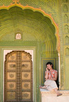 Woman chatting on mobile phone in decorated entrance of the