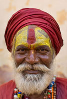 Portrait of sadhu in red turban and beard