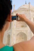 Woman photographing  the Taj Mahal at dawn,Close Up