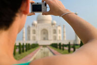 Woman photographing the Taj Mahal,Close Up