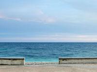 Seascape viewed through gap in wall