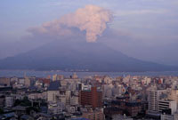 Mount Sakurajima erupting in front of skyline