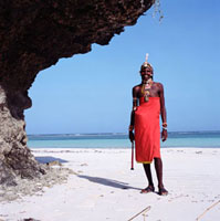 Smiling Samburu man standing on beach