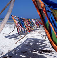 Colorful sarongs blowing in wind on the beach