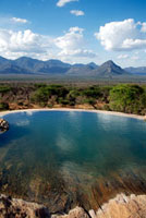 Empty infinity pool and grasslands
