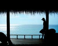 Woman on porch overlooking ocean