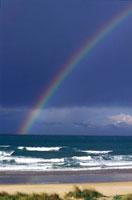 Rainbow over empty beach